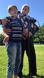 June 16, 2017 - USA - Suzanne Hodgkinson talks to news media reporters about her husband, congressional shooter James ''Tom'' Hodgkinson. With her is St. Clair County Sheriff's Chief Deputy Richard Wagner. (Credit Image: © Kaley Johnson/TNS via ZUMA Wire)