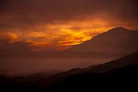 Sunrise through volcanic fumes from Mt. Bromo, Java