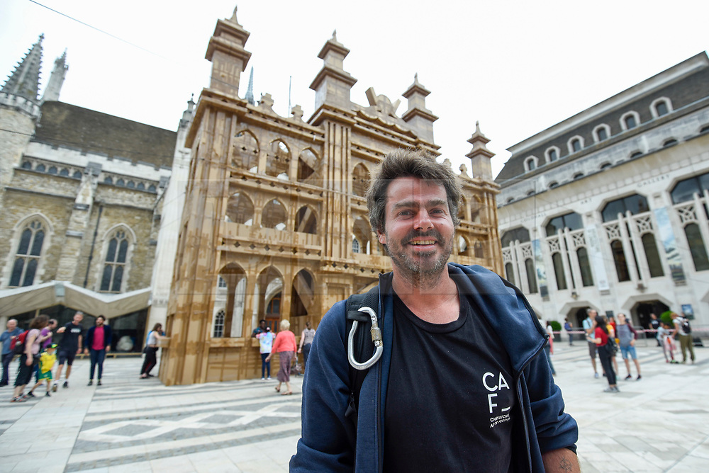 © Licensed to London News Pictures. 21/07/2019. LONDON, UK.  The People's Tower, a monumental cardboard structure, built by artist Olivier Grossetête (pictured) aided by a local volunteers, stands in Guildhall Yard.  Over 1,000 boxes have been used to build the 20m high artwork, inspired by the Guildhall building.  The four day construction process culminates in the structure being ceremonially torn down.  Photo credit: Stephen Chung/LNP