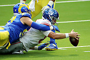 INGLEWOOD, CALIFORNIA - OCTOBER 04: Morgan Fox #97 of the Los Angeles Rams sacks Daniel Jones #8 of the New York Giants during the first half at SoFi Stadium on October 04, 2020 in Inglewood, California. (Photo by Katelyn Mulcahy/Getty Images)