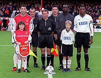 Martin Keown with the Arsenal mascot, match officials and Darryl Powell the Derby captain. Arsenal v Derby County. FA Premiership 11/11/2000. Credit: Colorsport.