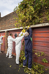 Homes for Haringey community clean up of housing estate garages, North London UK