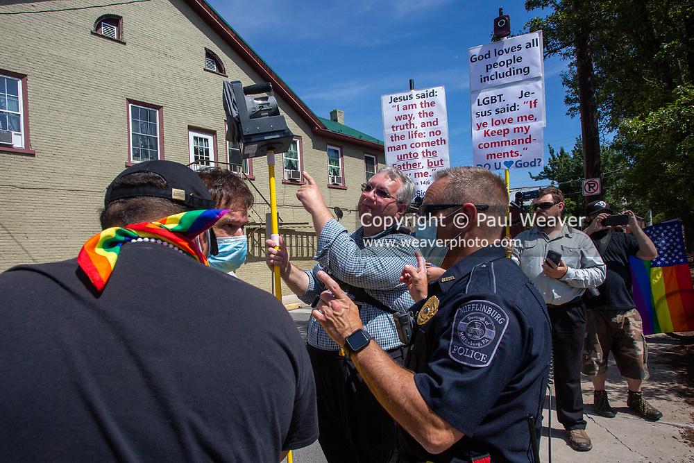 Mifflinburg Police Chief Jeffrey Hackenberg responds to a dispute between Mifflinburg Pride Event participants and counter-protesters.
