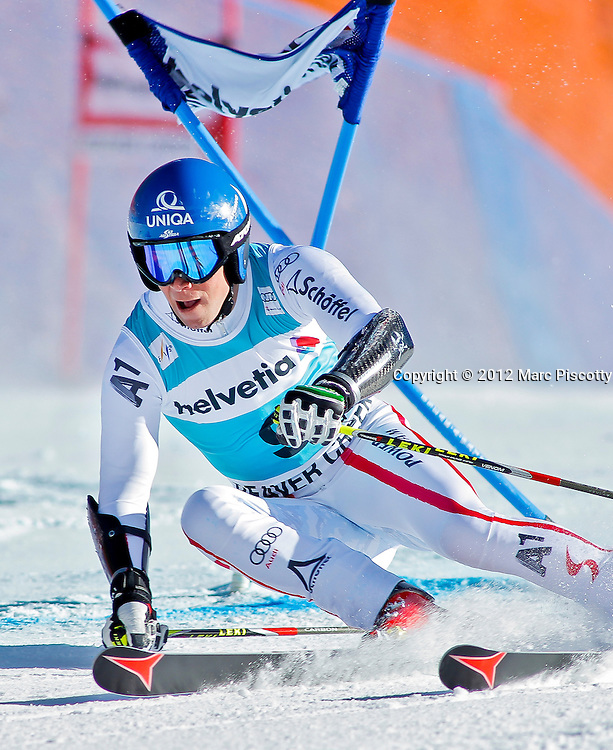 SHOT 12/2/12 2:15:09 PM - Austrian skier Benjamin Raich works his way past a gate during the Birds of Prey Men's Giant Slalom race at Beaver Creek Ski Resort in Beaver Creek, Co. on Sunday December 2, 2012. (Photo by Marc Piscotty / © 2012)