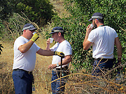 Scotland Yard forensic technicians search drains in Praia da Luz with  as police continue to look for the  body of Maddie McCann. <br /> ©Exclusivepix