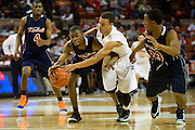 Randelle Jones (42) of Dallas Kimball fights for a lose ball against John Azzinaro (5) of San Antonio Northside Brennan during the UIL Conference 4A semifinals at the Frank Erwin Center in Austin on Thursday, March 7, 2013. (Cooper Neill/The Dallas Morning News)