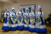 Russian women in traditional costumes in Barentsburg, a Russian coal mining settlement in Billefjorden, Spitsbergen, Norway
