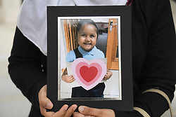 Shelina Begum, holds a picture of her five-year-old daughter Tafida Raqeeb, outside the Royal Courts of Justice in London, where she and her husband Mohammed Raqeeb, have won a ruling on whether treatment should be stopped for her.