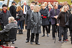 © Licensed to London News Pictures.  14/02/2013. BASINGSTOKE, UK. Mourners pay their respects during the funeral of Reg Presley at Basingstoke Crematorium. The lead singer of 1960s rock band The Troggs, who became famous with hits including Wild Thing, died aged 71 earlier this month. Photo credit: Cliff Hide/LNP