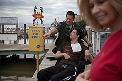 Judy Cox, her husband Wayne and their son, Chris, 29, a traumatic brain injury survivor are seen in Destin, Fla., Nov. 20, 2011. Judy and Wayne take care of their son, who was left with debilitating back pain after an A.T.V. accident. Cox underwent physical therapy to no avail and accidentally overdosed on Oxycontin, leaving him clinically deceased for 15 to 30 minutes. He was revived but suffered severe lack of oxygen to his brain and was diagnosed as minimally conscious. Cox's family entered him into a clinical trial, testing medicines that evoked Òparadoxical excitation,Ó such as Ambien, and have witnessed a heightened sense of awareness in their son.