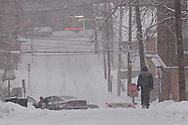 Middletown, New York -  A man walks down a hill during a snowstorm on Dec. 17. 2013.