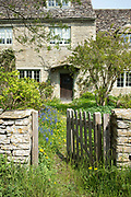 Quaint traditional country cottage in the rural village of Kelmscott in The Cotswolds, West Oxfordshire, UK