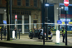 © Licensed to London News Pictures. 27/02/2021. Manchester, UK. Police respond to an incident in St Peter's Square in Manchester City Centre . Several blocks around a scene have been taped off<br />