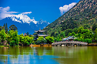 The idyllic Black Dragon Pool with the  18,360 foot Jade Dragon Snow Mountain behind, Lijiang, Yunnan Province, China.