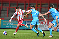 Stevenage forward Jack Aitchison(27)  shoots at goal misses the target during the EFL Sky Bet League 2 match between Stevenage and Cheltenham Town at the Lamex Stadium, Stevenage, England on 20 April 2021.