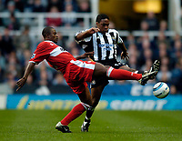 Photo. Andrew Unwin, Digitalsport<br /> Newcastle United v Middlesbrough, Barclays Premiership, St James' Park, Newcastle upon Tyne 27/04/2005.<br /> Middlesbrough's George Boateng (L) stretches out a leg to deny Newcastle's Charles N'Zogbia.