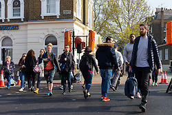 The intersection at Highbury Corner where temporary traffic lights give pedestrians, who have to wait 60 seconds, just 6 seconds of green to cross the busy A1, a major arterial road, outside the entrance to the Highbury & Islington Tube station. London, April 18 2019.
