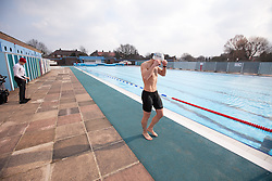 © London News Pictures. 28/03/12. Local resident prepares himself for training in the 50m Olympic sized pool. Charlton Lido in South London, opens today 28/03/13 after extensive refurbishment work to the heated Olympic sized outdoor pool in Charlton, London, England. Picture credit should read Manu Palomeque/LNP