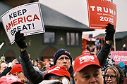 """06 DECEMBER 2020 - DES MOINES, IOWA: A man holds up signs in support of US President Donald Trump. About 1,000 supporters of outgoing US President Donald Trump rallied in Des Moines Sunday to show their support for the President and to protest the outcome of the US Presidential election. They started with a rally in the suburbs of Des Moines then drove in a motorcade through the city, ending at the State Capitol. They repeated many of Trump's discredited claims that the election was marked by fraud and that Trump actually won. The protest was a part of the national """"March for Trump"""" effort, culminating in a march in Washington DC on December 13. Joe Biden won the election, with 306 electoral votes to Trump's 232.       PHOTO BY JACK KURTZ"""