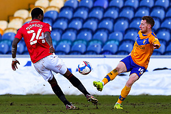 Stephen Quinn of Mansfield Town gets the ball away from Yann Songo'o of Morecambe - Mandatory by-line: Ryan Crockett/JMP - 27/02/2021 - FOOTBALL - One Call Stadium - Mansfield, England - Mansfield Town v Morecambe - Sky Bet League Two
