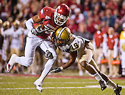 Arkansas receiver Greg Childs (85) is brought down by Vanderbilt defensive back Casey Hayward (19) during the fourth quarter of an NCAA college football game in Fayetteville, Ark., Saturday, Oct. 30, 2010. Childs was injured on the play.