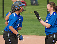 Middletown, New York - Middletown players celebrate during a varsity girls' softball game on May 14, 2014.