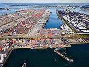 Nederland, Zuid-Holland, Rotterdam, 14-09-2019; Tweede Maasvlakte (MV2),  Hartelhaven (voorgrond), Amazonehaven, met ECT Delta Terminal(containers). Mississippihaven met EMO (overslag droge bulk, zoals erts en kolen). <br /> Second Maasvlakte (MV2), Maasvlakte Plaza. Amazonehaven, with ECT Delta Terminal (containers) and Mississippihaven with EMO (transshipment of dry bulk, such as ore and coal).<br /> <br /> luchtfoto (toeslag op standard tarieven);<br /> aerial photo (additional fee required);<br /> copyright foto/photo Siebe Swart