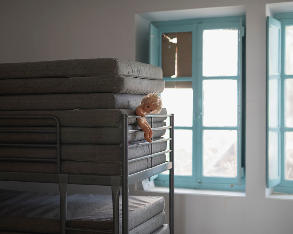 An abandoned child's doll on a bunkbed in Villa Artemis, a shelter for 30 refugee women and their children in the grounds of Leros Hospital. <br /> <br /> Opened in September 2015, the shelter was run by the Leros Solidarity Network. However, Villa Artemis was closed down shortly after the opening of a 'Hotspot' (EU-run migrant's reception centres) camp in Lepida in February 2016.