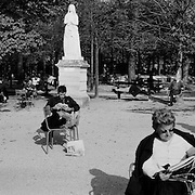 Individuals politely space themselves while reading and relaxing in the Jardin du Luxembourg in Paris, France. October 17, 2007. Photo Tim Clayton..Paris is often known as 'The City of Love' but like any major City in the world, the inhabitants often live a singular existence, going about their daily lives in relative solitude. Parisians are respectful of each others space, often courteous and polite while extremely conscious of their own image. While love can be seen openly around the streets of Paris, so can the separate lives of Parisians.