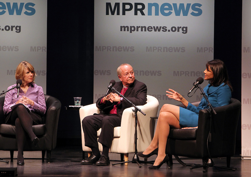 Bishop Gene Robinson, center, the nation's first openly gay Episcopal bishop, listens to Sarah Walker, right, Minnesotans United for All Families board member, speak about their common anti-amendment stance  during the Marriage Amendment Debate hosted by Kerri Miller and presented by Minnesota Public Radio News at the Fitzgerald Theater in St. Paul, Minnesota.