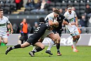 George Turner of Glasgow Warriors ©makes a break through the tackle from Dan Evans (l) and Sam Davies ® of the Ospreys.  Guinness Pro14 rugby match, Ospreys v Glasgow Warriors Rugby at the Liberty Stadium in Swansea, South Wales on Sunday 26th November 2017. <br /> pic by Andrew Orchard, Andrew Orchard sports photography.