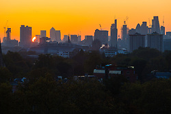 London, October 27 2017. The sun makes its appearance as the day breaks over London's skyline, seen from Primrose Hill. © Paul Davey