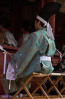 Kannushi is a shinto shrine priest sometimes known as shinshoku. Kannushi is a mediator between gods and humans, and served the kami on behalf of humanity. He is responsible for the maintenance of a shinto shrine, in this case Tsurugaoka Hachimangu shrine in Kamakura.  It is commonplace for Kannushi to marry - his children normally inherit their position at their shrine or a related one.  Shinto priest clothes do not have any particular religious significance, but are garments very similar to those worn in the past by the Imperial court. Miko or shrine maidens whose duties are sacred cleansing, ritual and performing kagara dance.
