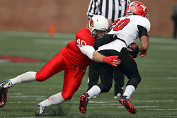 08 November 2014: Alex Donnelly digs into the turf as he wraps up Jody Webb during an NCAA Missouri Valley Football Conference game between the Youngstown State Penguins and the Illinois State Redbirds at Hancock Stadium in Normal Illinois