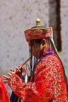 Musician playing horn, Paro Tsechu (Festival), Paro, Bhutan