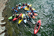 """Participants in the First Descents kayaking program form an """"Eddy flower"""" as they begin their Snake River paddling trip from Astoria on Thursday. First Descents provides free outdoor adventures for young adult cancer fighters and survivors across the country. See Sports for a story and more photos."""