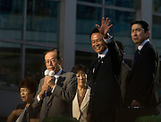 current PM Taro Aso, waves to a crowd in central Tokyo, during the campaign for the  election to fill the  position of Japanese Prime  Minister  Abe, which was one by Yasuo Fukuda won the  party election but resignes a year after taking office he was replaced by  Aso..