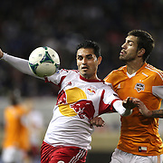 Fabian Espindola, New York Red Bulls, is challenged by Eric Brunner, Houston Dynamo, during the New York Red Bulls V Houston Dynamo , Major League Soccer second leg of the Eastern Conference Semifinals match at Red Bull Arena, Harrison, New Jersey. USA. 6th November 2013. Photo Tim Clayton