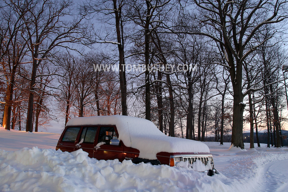 Middletown, NY - A sports utility vehicle is covered by snow in a parking lot after a snowstorm on Feb. 23, 2008.
