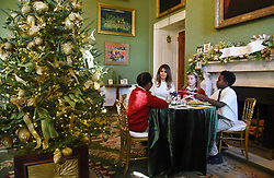 First Lady Melania Trump participates in arts and crafts projects with children and students from Joint Base Andrews in the East Wing of the White House in Washington, DC, November 27, 2017. Credit: Olivier Douliery / Pool via CNP. 27 Nov 2017 Pictured: First Lady Melania Trump participates in arts and crafts projects with children and students from Joint Base Andrews in the Green Room of the White House in Washington, DC, November 27, 2017. Credit: Olivier Douliery / Pool via CNP. Photo credit: Olivier Douliery - Pool via CNP / MEGA TheMegaAgency.com +1 888 505 6342