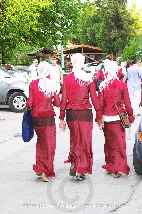 Young girls in a procession parade dressed in traditional clothes for a traditional marriage Historic town of Mostar. Federation Bosne i Hercegovine. Bosnia Herzegovina, Europe.