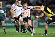 Drew Mitchell pushes off Piri Weepu. NSW Waratahs v Hurricanes. 2010 Super 14 Rugby Union round 14 match played at the Sydney Football Stadium, Moore Park Australia. Friday 14 May 2010. Photo: Clay Cross/PHOTOSPORT