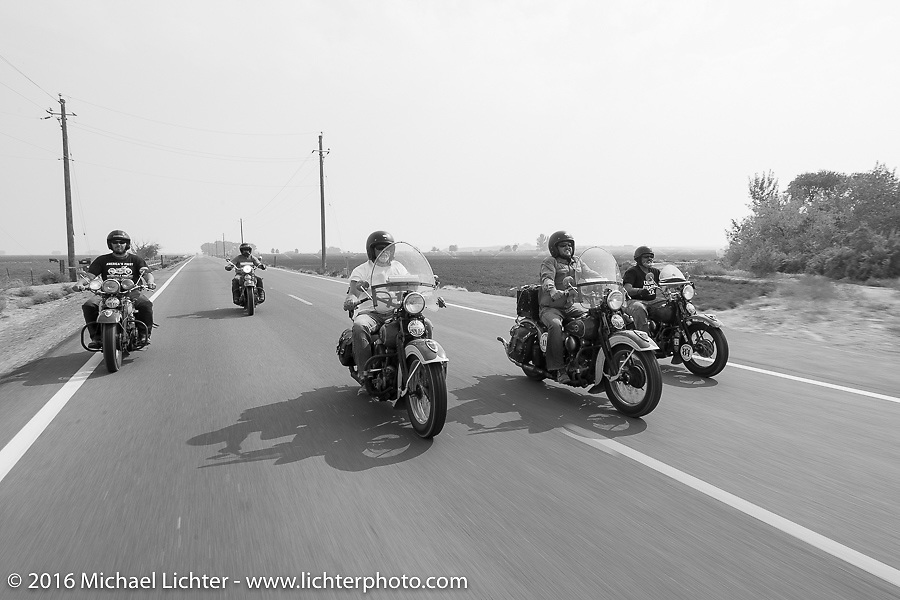 """Left to right - Jason Sims riding a Carl's Cycle 1939 Harley-Davidson Knucklehead, Scott Wages - the """"Golden Ticket"""" winner who won the opportunity to ride the entire Cannonball on this 1936 Harley-Davidson Knucklehead from Carl's Cycle, Ken McManus on his 1936 Harley-Davidson Knucklehead, Ken's son Matt McManus on an exactly identical machine and Carl Olsen with his 1936 Harley-Davidson Knucklehead during stage 13 (257 miles) of the Motorcycle Cannonball Cross-Country Endurance Run, which on this day ran from Elko, NV to Meridian, Idaho, USA. Thursday, September 18, 2014.  Photography ©2014 Michael Lichter."""
