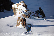 Backcountry skier Sterling Roop drops into a steep couloir below the summit of Hayden Peak, San Juan Mountains, Colorado.