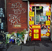 """A memorial has been placed where a man called Dennis died on the  A227 Coldharbour Lane, London, England, UK. If we drove past this place where someone's life ended, the victim would just be an anonymous statistic but flowers are left to die too and touching poems and dedications are written by family and loved-ones. One reads: """"This was a good man."""" From a project about makeshift shrines: Britons have long installed memorials in the landscape: Statues and monuments to war heroes, Princesses and the socially privileged. But nowadays we lay wreaths to those who die suddenly - ordinary folk killed as pedestrians, as drivers or by alcohol, all celebrated on our roadsides and in cities with simple, haunting roadside remberences."""