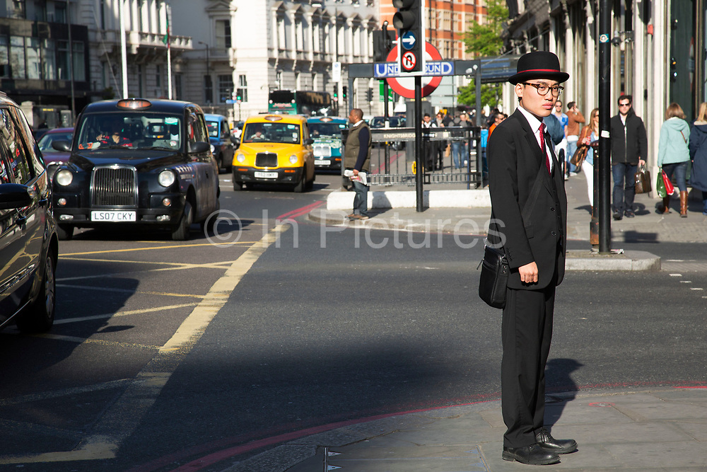 Information officer outside Knightsbridge underground station. In a selected few boroughs of West London, wealth has changed over the last couple of decades. Traditionally wealthy parts of town, have developed into new affluent playgrounds of the super rich. With influxes of foreign money in particular from the Middle-East. The UK capital is home to more multimillionaires than any other city in the world according to recent figures. Boasting a staggering 4,224 'ultra-high net worth' residents - people with a net worth of more than $30million, or £19.2million.. London, England, UK.
