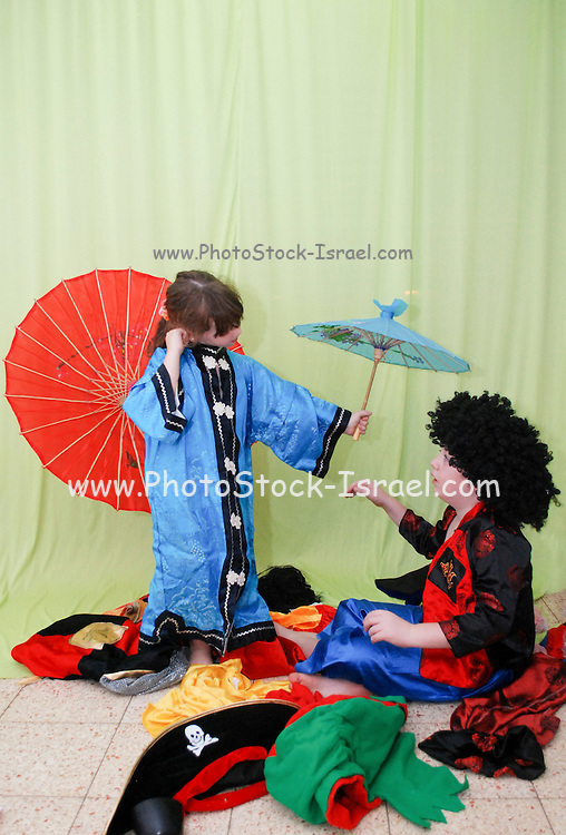Two children boy aged 8 and girl aged 5 play and dressup with costumes