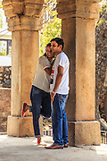 Young couple poses in Hauz Khas, New Delhi, India. In India it is typical that couple photography happens in some historical place.