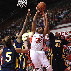 Jan 18, 2009; Piscataway, NJ, USA;  Rutgers guard Brittany Ray (35) fights through the Marquette defense for a layup during the first half of Rutgers' 76-53 victory at the Louis Brown Athletic Center.