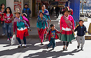 A campesino family shops in Huaraz, Callejon de Huaylas Valley, Ancash Region, Peru, Andes Mountains, South America.